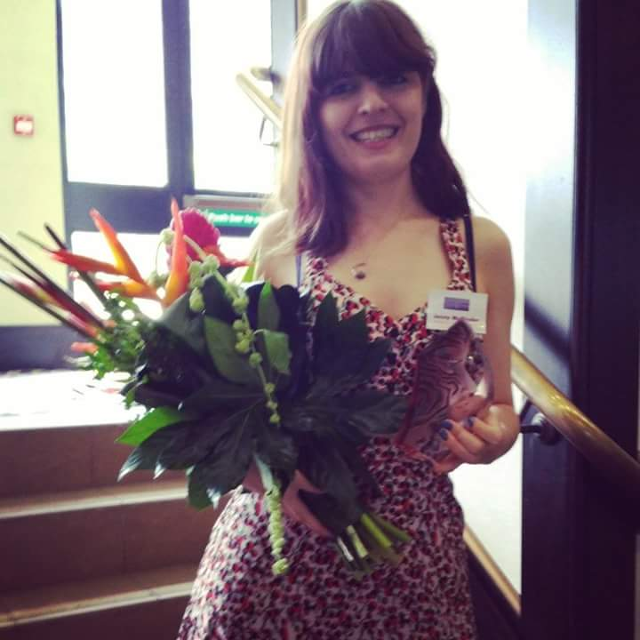 Posing with my award and flowers
