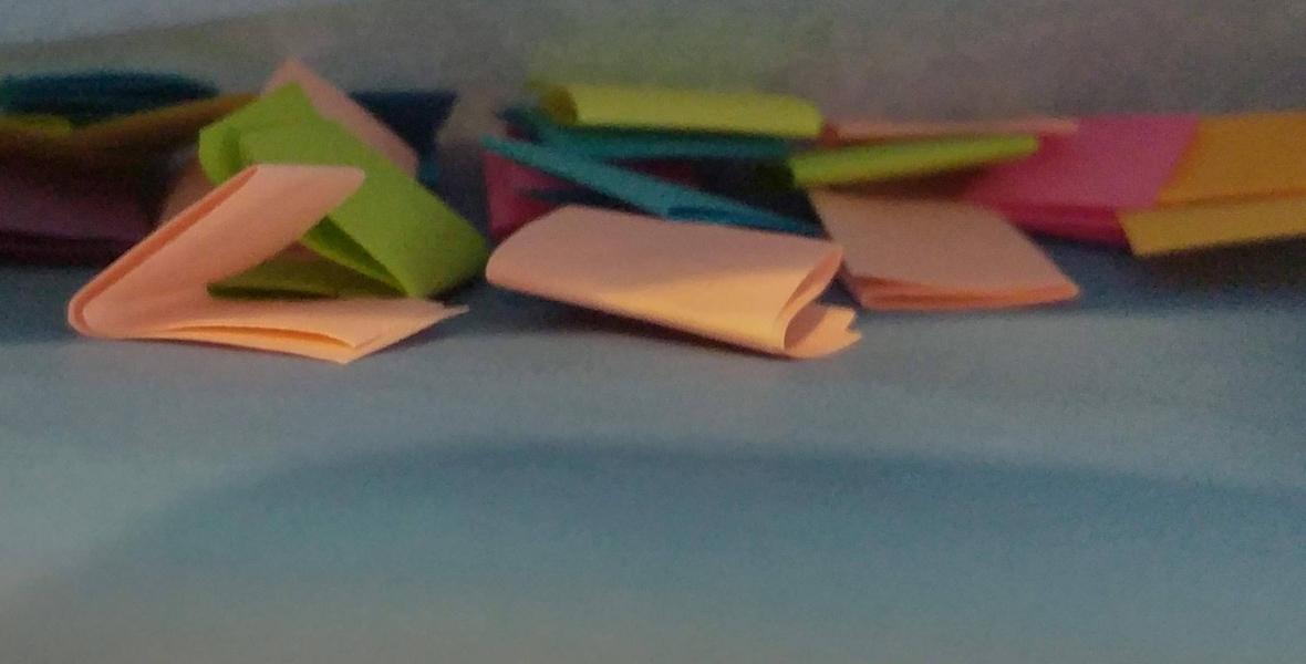 Envelope full of colourful folded paper